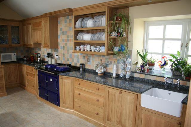 Oak kitchen fitted with Belfast sink, bridge kitchen taps, open plate rack