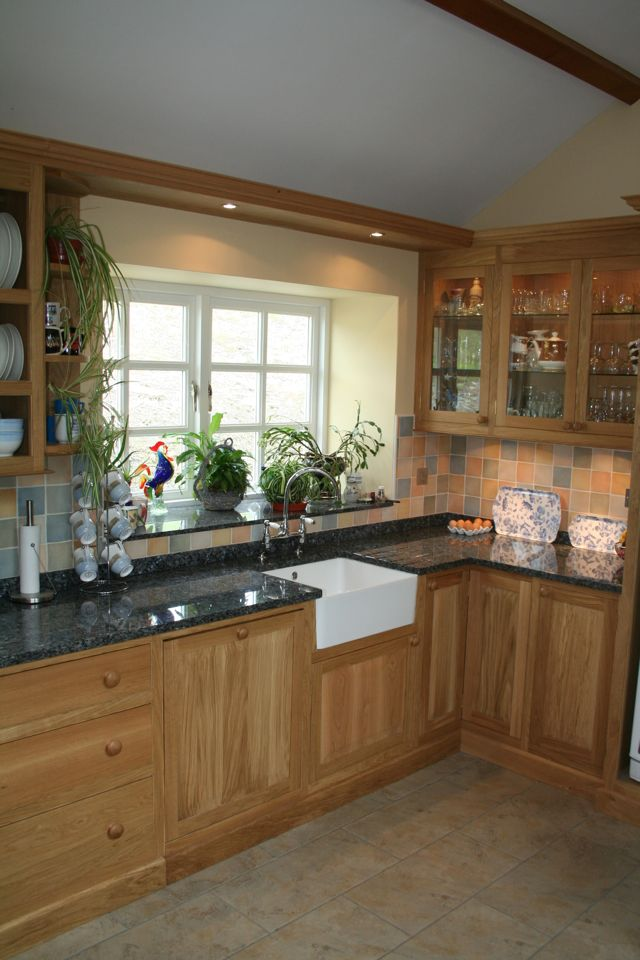 Belfast sink area in a traditional oak kitchen style with LED lighting above sink