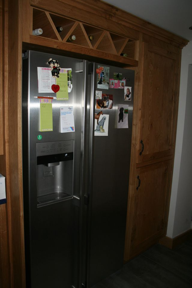 American style fridge/freezer with bespoke wine rack built above