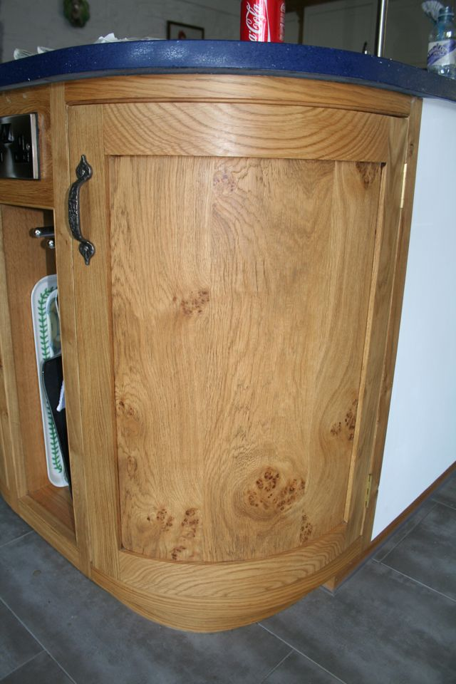 Curved island unit door made from pipi oak