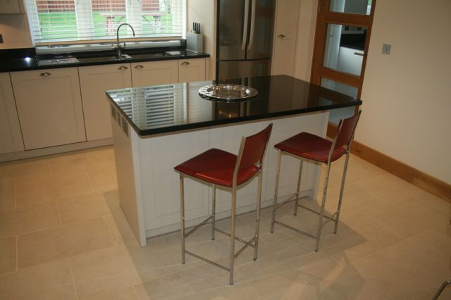 Island unit with granite overhand for breakfast bar area