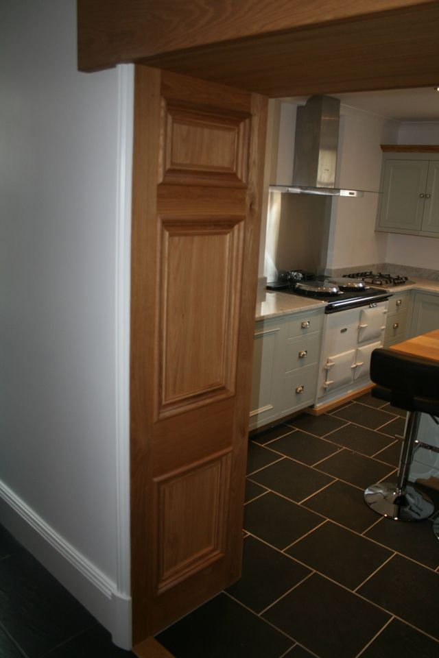 Painted kitchen with traditional oak wall panels