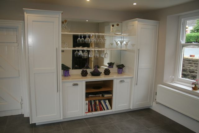 Glass display area with with mirror back and bespoke wine glass rack
