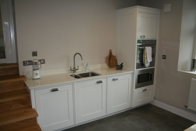 composite granite with under mounted sink and eye level oven and built in microwave
