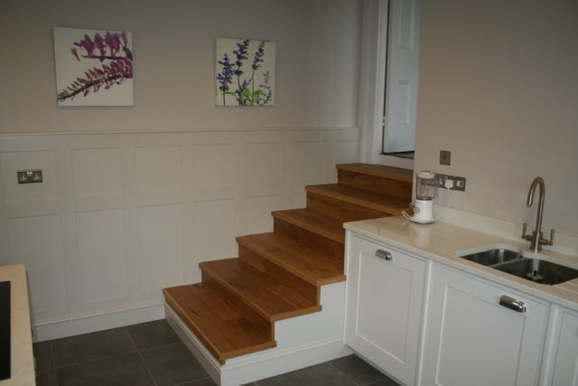 Oak staircase with painted wall panels