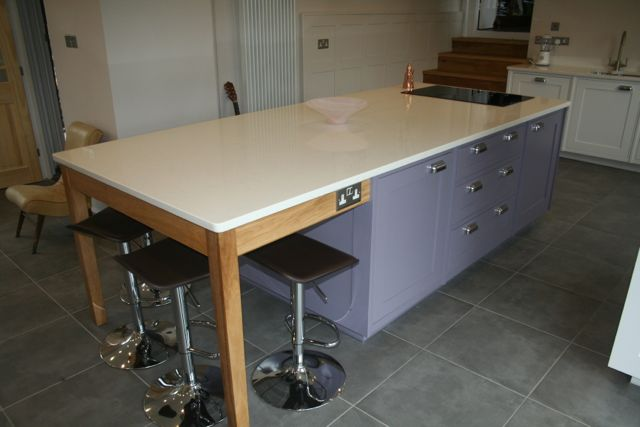 End island unit consisting of an european oak table base to create breakfast bar area with electric sockets