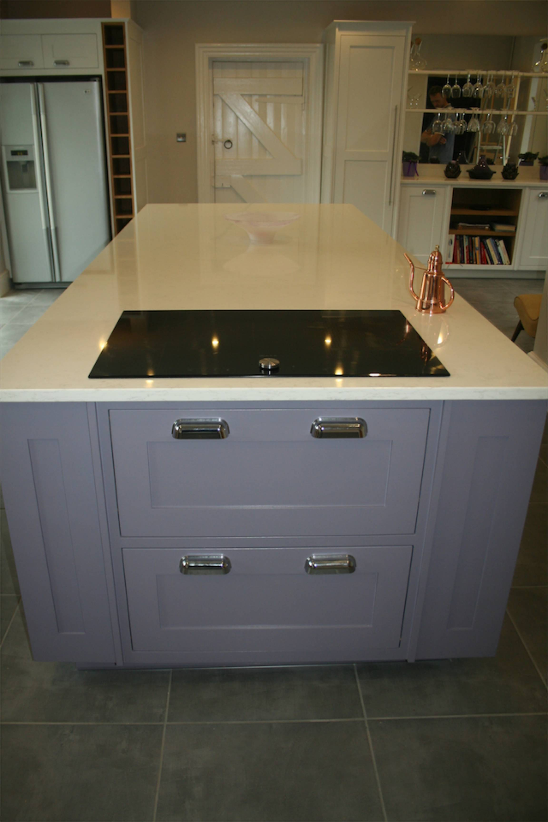Integrated induction hob with purpose made, bespoke pot drawers